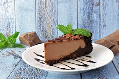 Chocolate cheesecake still life with rustic blue wood background Royalty Free Stock Images