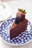 Slice of chocolate cheesecake topping with fresh strawberry and blackberry.  Royalty Free Stock Photo