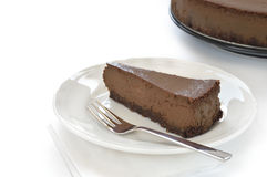 Slice of chocolate cheesecake on white plate Royalty Free Stock Photos