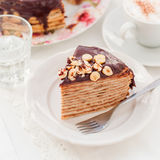 A Slice of Chocolate, Hazelnut and Cottage Cheese Crepe Cake Stock Photos