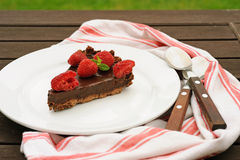 Slice of chocolate tart with raspberry Royalty Free Stock Photography