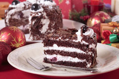 Slice of Christmas black forest gateau cake on plate with decoration Royalty Free Stock Images