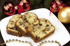 Slice of Christmas cake decorated with walnuts royalty free stock image
