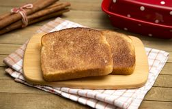 Slice of Cinnamon Toast. Classic Cinnamon Toast on a Rustic Wooden Table royalty free stock photography