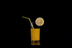 A slice of citrus fruit on a glass orange Stock Photo