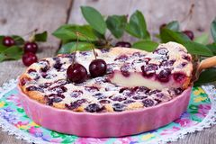 Slice of clafoutis with cherry in ceramic form. Close-up Royalty Free Stock Photos