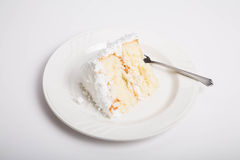Slice of Coconut Cake on White Counter Stock Photos