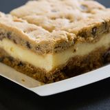 A slice of a coffee cake on a plate. With crumbs stock photo
