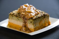 A slice of a coffee cake on a plate. With crumbs stock photos