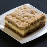 A slice of a coffee cake on a plate. With crumbs stock photography