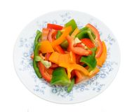 Slice of colorful bell peppers on dish Stock Images