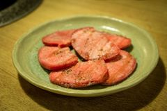 Slice cow tongue with salt and pepper. royalty free stock images