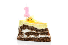Slice of cream birthday cake with candle Stock Photos