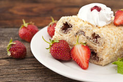 Slice of cream puff cake with strawberry on wooden table. Select Royalty Free Stock Images