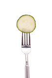 Slice of cucumber on a fork Royalty Free Stock Photography