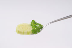 Slice of cucumber on fork Stock Photography