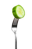 Slice of cucumber on a fork Stock Image