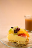 Slice of custard pie topped with fruit Royalty Free Stock Photo