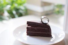 Dark chocolate cake. tasty delicious dessert on white plate. hom Stock Images