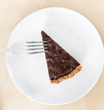 Slice of dark chocolate and marron glacés cake Stock Image