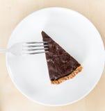 Slice of dark chocolate and marron glacés cake Stock Image