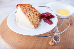 Slice of date cake on a white plate.  Stock Photos