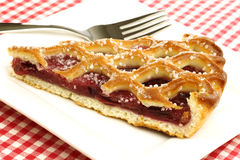 Slice of decorated cherry pie  Royalty Free Stock Image