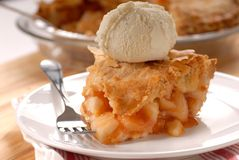 Slice of deep dish apple pie