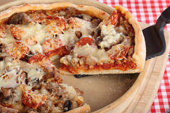 Slice of Deep Dish Pizza Royalty Free Stock Image