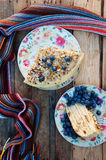 Slice of delicious  cake with fresh blueberry on wooden backgroup. Piece of blueberry cake, piece of cake on white plate with blue Royalty Free Stock Images
