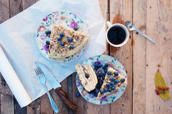Slice of delicious  cake with fresh blueberry on wooden backgroup. Piece of blueberry cake, piece of cake on white plate with blue Royalty Free Stock Photography