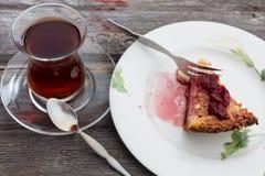 Slice of delicious cheesecake with Turkish tea Stock Photo