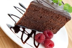 Slice of delicious chocolate cake Stock Photos