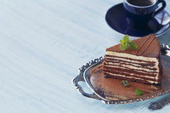Slice of delicious chocolate cake on silver plate Stock Photos