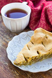 Slice of delicious fresh baked american apple pie on a plate Stock Images