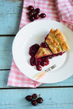 Slice of delicious homemade cherry pie Royalty Free Stock Photo