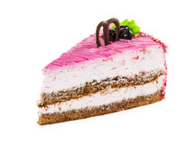 Slice of delicious layered cake with pink glazed, chocolate and Royalty Free Stock Photography