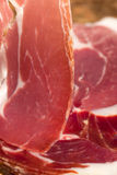 Slice of dry cured ham macro Royalty Free Stock Image