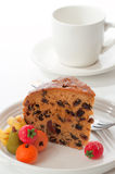Slice Of Dundee Cake. With marzipan fruits on a white background Royalty Free Stock Images