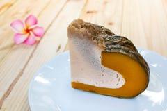 Slice of Egg Custard in the pumpkin. Stock Images