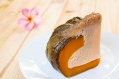 Slice of Egg Custard in the pumpkin. Stock Photos