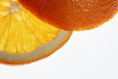Slice and end of an orange. Part of slice and end of orange, isolated, backlit Royalty Free Stock Photography