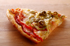 Slice of fesh italian pizza over background Stock Images
