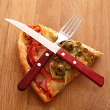Slice of fesh italian pizza over background Royalty Free Stock Photography