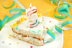 Slice of fifth birthday cake Royalty Free Stock Photos