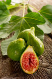 Slice fig with leaf Royalty Free Stock Photos