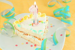 Slice first birthday cake Royalty Free Stock Photos