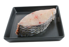 A slice of  fish on dish isolate on white background Stock Photography