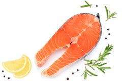 Slice of fish salmon with lemon, rosemary isolated on white background with copy space for your text. Top view. Flat lay. Slice of red fish salmon with lemon stock photo