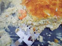 Slice of flaky Pastry Fish Pie with Prawn royalty free stock images